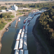 Grain barges in a shallow river